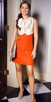 Love the pop of bright orange paired with a large bow! This look is classic but also incorporates a fun element as well.