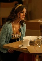 Blair's look is timeless with a knit sweater and large pearl necklace